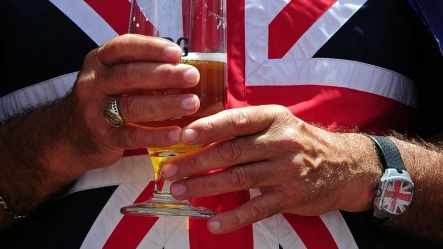 Britain's government on Wednesday ditched plans to introduce a minimum price for alcohol in England and Wales to deal with binge-drinking, sparking anger from health campaigners.