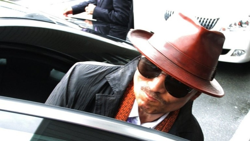 """Kenichi Shinoda, the boss of Japan's largest """"yakuza"""" gang, the Yamaguchi-gumi, gets into a car in Kobe, on April 9, 2011. A woman is suing Shinoda, seeking a refund of protection money paid to gangsters threatening to torch her bar, reports say"""