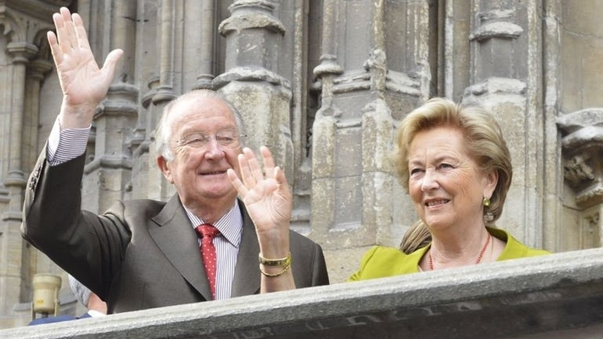 King Albert II and Queen Paola of Belgium wave from a balcony during their visit to Gent, July 17, 2013. Belgium is beating the drum but not too loudly as King Albert II abdicates in favour of son Philippe in sober weekend celebrations clouded by doubts over the new king's political dexterity and shorn of foreign royals.