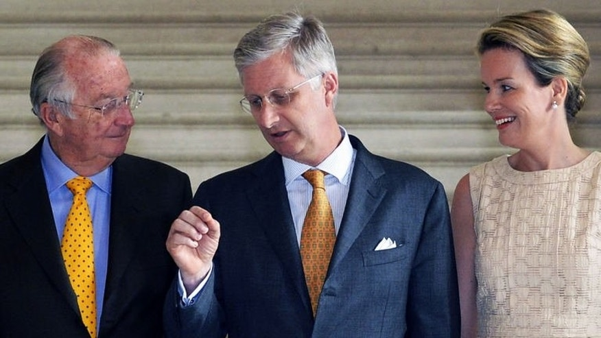 (L-R) Belgium's King Albert II, Crown Prince Philippe and Princess Mathilde attend a reception at the royal palace of Laeken, Brussels on July 12, 2013.