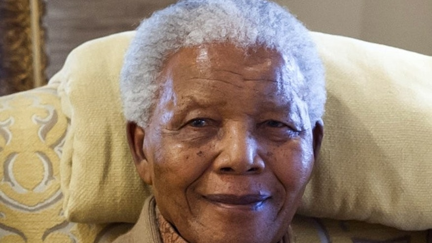 Nelson Mandela, seen at his home in Qunu, Eastern Cape, on July 17, 2012 -- on the eve of his last birthday. The former South African president is set to spend his 95th birthday in hospital Thursday, but across the world admirers hope to honour their icon's legacy through millions of acts of kindness.