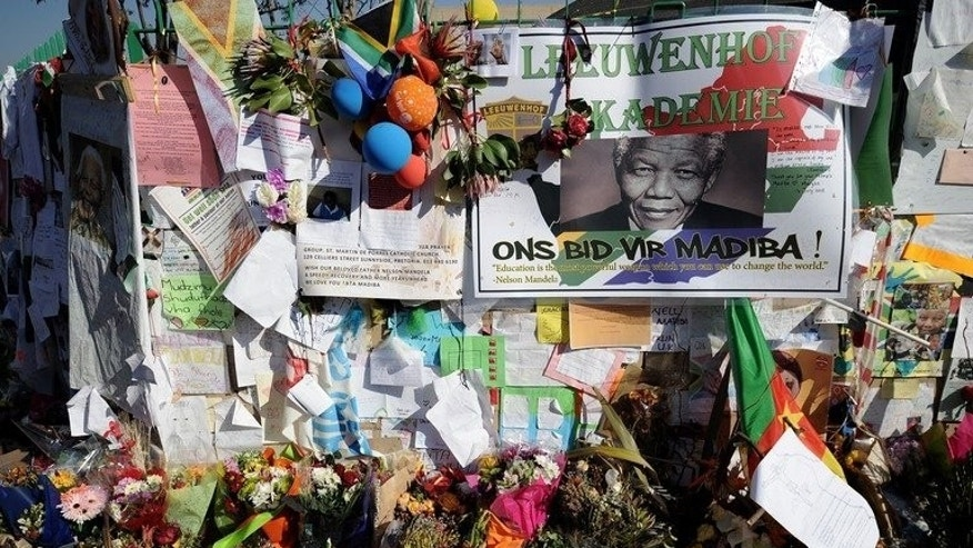 A wall of tributes to Nelson Mandela outside his hospital in Pretoria on July 16, 2013. The former South African President is set to spend his 95th birthday in hospital Thursday, but across the world admirers hope to honour their icon's legacy through millions of acts of kindness.