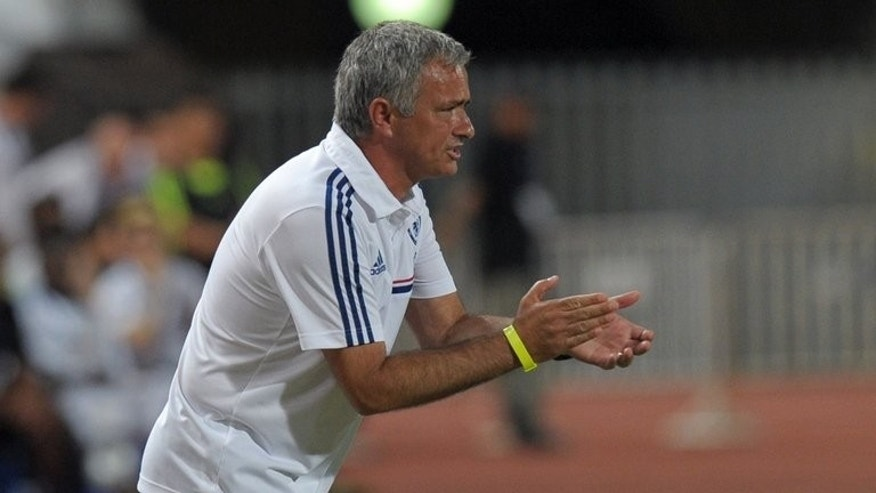 Chelsea manager Jose Mourinho gestures to his players during the exhibition match in Bangkok on July 17, 2013. Mourinho launched his new reign at Chelsea with a sensational bid for Manchester United star Wayne Rooney.