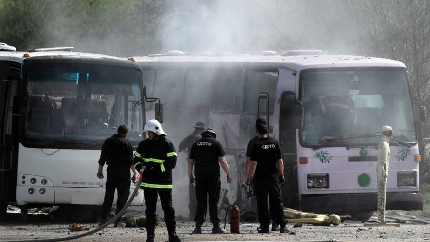 During a re-enactment on April 26, 2013, investigators examine the site where two busses exploded in Bulgaria in July 2012, in an effort to resolve some of the many still unanswered questions. The Burgas airport bus bombing killed five Israeli tourists near the town of Ihtiman.