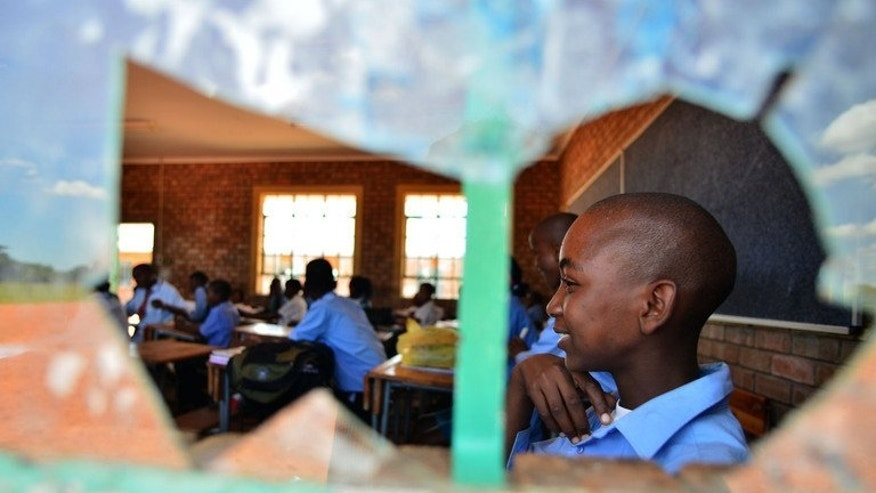 Students attend a class at the Alapha Secondary School on February 7, 2013 in Bayswater, a village in Limpopo province, South Africa. Like many rural schools across the country, Alapha magnifies the failings of the country's public education system, which has been ranked among the worst in the world.