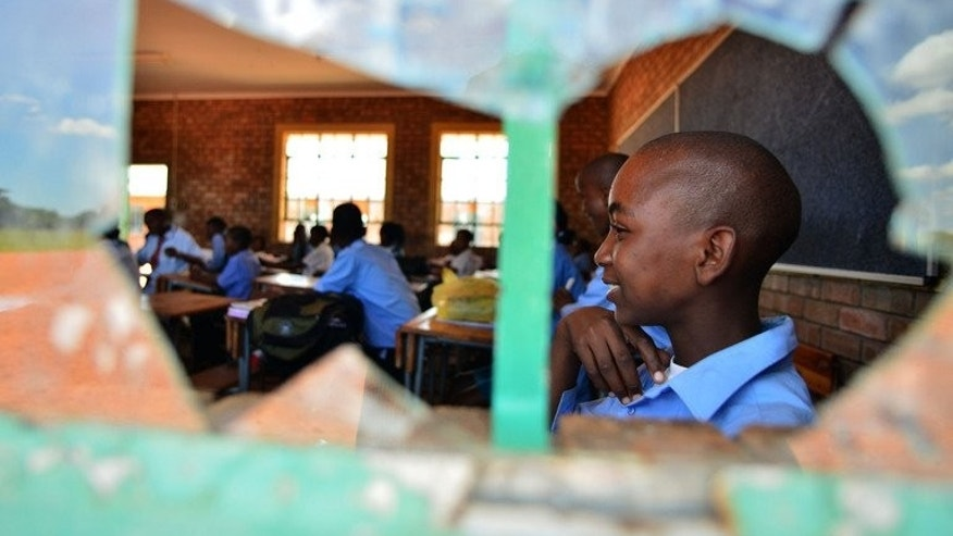 Students at class at the Alapha Secondary School on February 7, 2013 in Bayswater, South Africa. Despite the country's position as the continent's largest economy, its public education system is in a dire state.