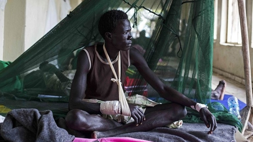 A man injured during tribal clashes in Jonglei state, sits in a hospital in Bor, South Sudan on July 15. The country's deputy defence chief has said neither his troops nor United Nations peacekeepers are able to protect civilians in conflict-wracked Jonglei, where thousands of rival ethnic militiamen are fighting.