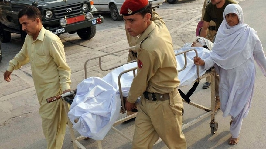 Pakistani soldiers carry injured Malala Yousafzai, to an army hospital following an attack by Taliban gunmen in Peshawar on October 9, 2012. Gunmen from the Tehreek-e-Taliban Pakistan (TTP) shot Malala, now 16, in the head in her home town in Swat after she had campaigned for the right of girls to go to school.