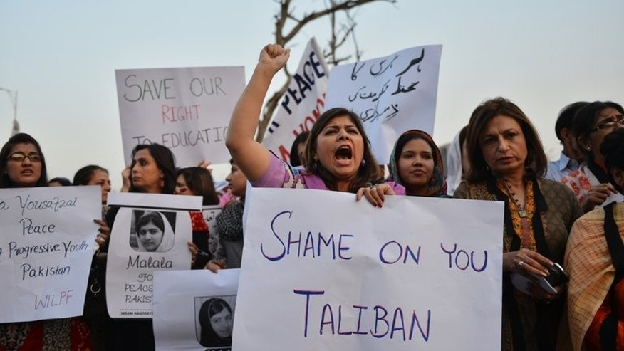 "Pakistani activists protest against the Taliban after gunmen shot Malala Yousafzai, in Islamabad on October 10, 2012. The Taliban has accused Malala of seeking to promote an education system begun by British colonialists to produce ""Asians in blood but English in taste"", and said students should study Islam and not the ""satanic or secular curriculum""."