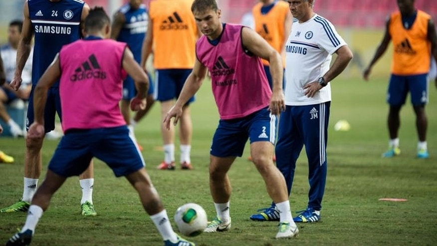 Chelsea manager Jose Mourinho (right) supervises a training session at the Rajamangala stadium in Bangkok, on July 16, 2013. Thailand have denied a father's claim that a boy chosen as a Chelsea mascot was forced to make way for the prime minister's football-mad son.