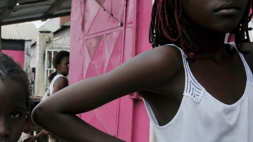 Gabonese youths stand outside a shop in Libreville on September 6, 2009. West African human trafficking is spawinging a Gabonese hell for some children.