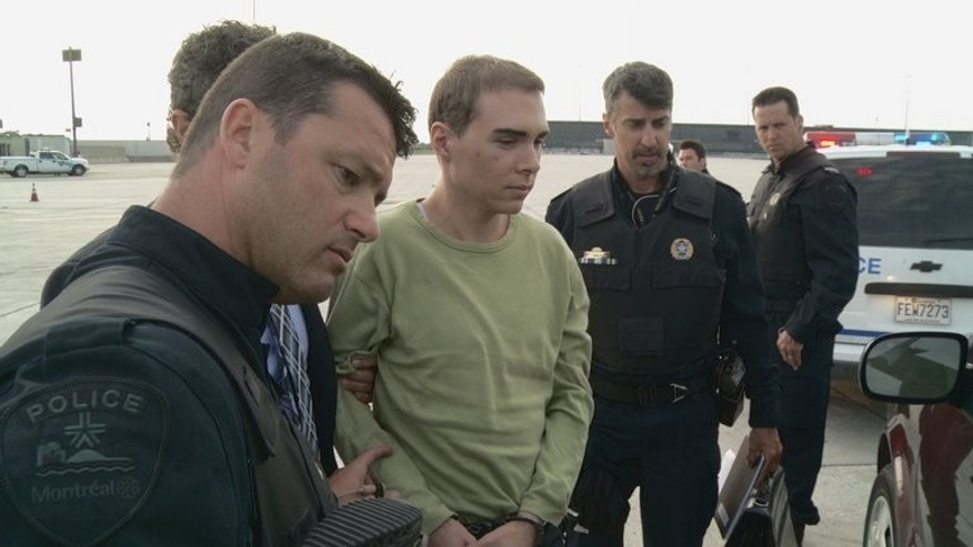 This photograph obtained courtesy of the Service de Police de la Ville de Montreal (SPVM) shows Luka Rocco Magnotta (C) escorted by police upon arrival from Germany on June 18, 2012.