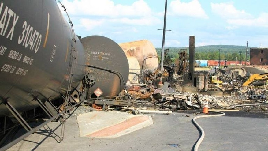 This undated picture released by Quebec police (Surete du Quebec) on July 12, 2013 shows derailed train wagons in Lac-Megantic following the derailment and explosion of a train loaded with crude oil on July 6. Police announced Thursday they had found four more bodies amid the ruins of Lac-Megantic, bringing the body count to 42.