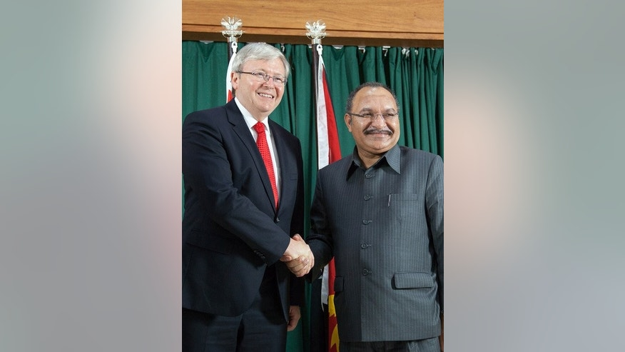 Australian PM Kevin Rudd (L) is greeted by Papua New Guinea's PM Peter O'Neill, in Port Moresby, on July 15, 2013. Under a deal Rudd is said to have thrashed out in Port Moresby, asylum-seekers arriving illegally by boat would not only be processed in other countries, such as poverty-stricken PNG, but also permanently resettled there.