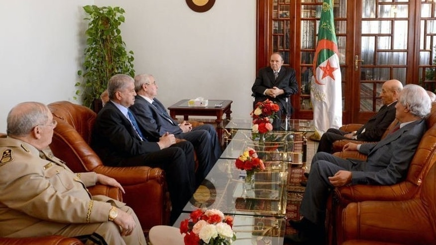 Abdelaziz Bouteflika (C) at a meeting following his arrival in Algeria after being hospitalised in France. In a brief video broadcast on state television on Tuesday, Bouteflika appeared pale and tense as he was seen meeting his inner circle of officials.