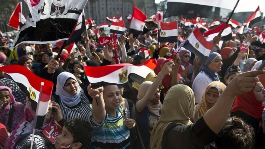 Egyptian women protest in Cairo's landmark Tahrir Square on July 2, 2013. Canada announced funding to help more women get elected in Middle East and North African nations undertaking democratic reforms.