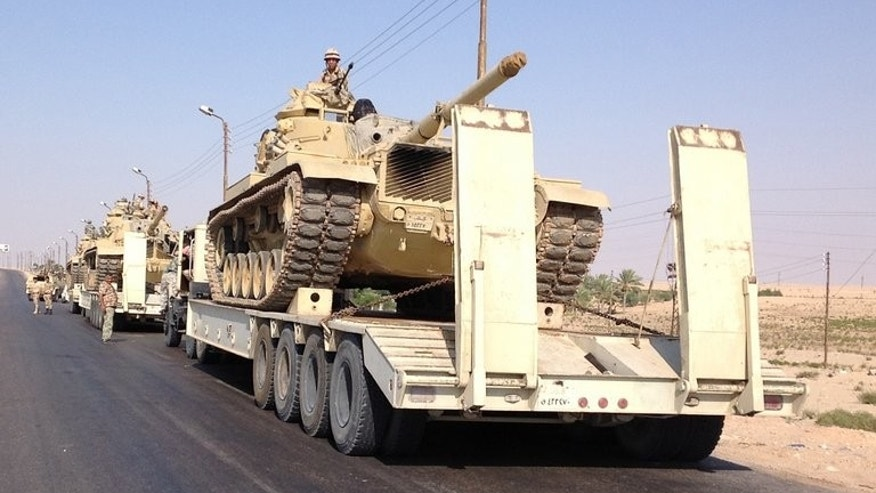 Tanks are deployed in the Sinai town of Al-Arish on Tuesday. Ten jihadists have been killed in Egypt's restive Sinai peninsula in the past two days during an army offensive against Islamist militants, the official MENA news agency reported on Thursday.