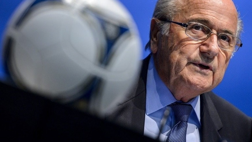 FIFA President Sepp Blatter looks on behind a football during a press conference on September 28, 2012 in Zurich. Blatter will push for the 2022 World Cup in Qatar to be moved to the winter after getting a personal taste of the Middle East's blast furnace climate.