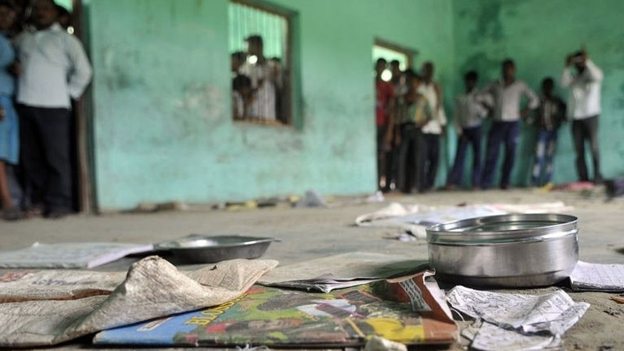 The scattered belongings of children who died after consuming a free meal lie on the floor at the school in the Saran district of Bihar state on July 17, 2013. Some 30 children remain ill in hospitals in the state capital Patna and the city of Chhapra after eating the food, which initial tests showed may have been tainted with insecticide.