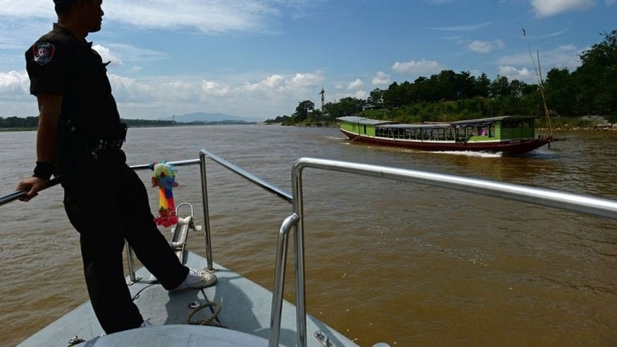 """Thai Marine Border Police patrol along the Mekong river, which marks the border between Thailand and Laos, May 28, 2013. Drug gang clashes with the army or the police are common. In one incident in 2012, eight suspected traffickers were killed by security forces and Manop predicts things will only get """"more violent""""."""