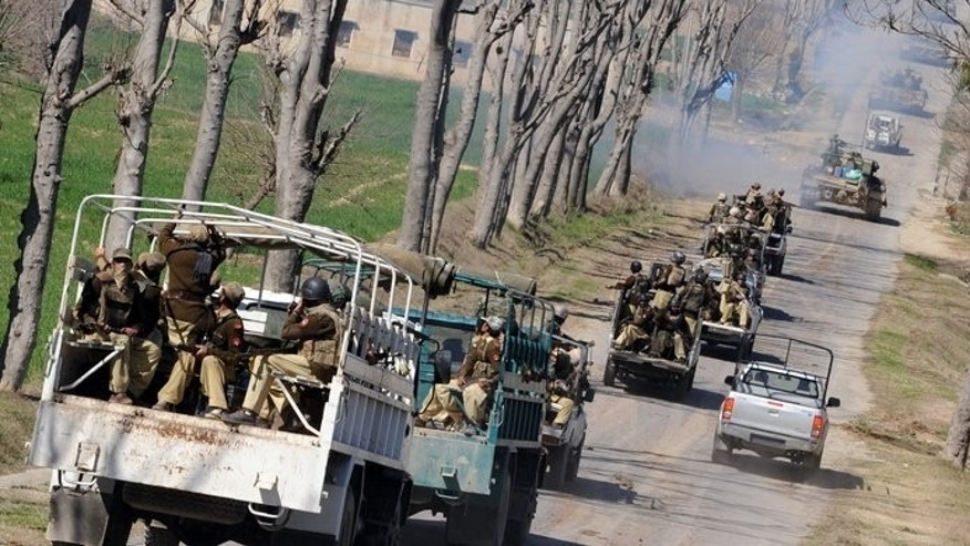 Pakistani paramilitary soldiers patrol in the remote Bajaur Agency on February 28, 2009. Gunmen ambushed a vehicle carrying government paramilitary forces in a restive Pakistani tribal region near the Afghan border on Thursday, killing two soldiers, officials said.