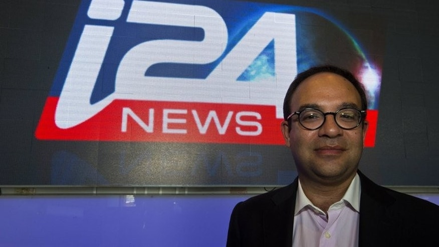 "CEO of the new Israeli-based TV channel i24news Franck Melloul poses at the station's headquaters on June 17, 2013 in Tel Aviv's Jaffa district. The launch of the channel in English, French and Arabic is aimed at giving a ""different view"" of the Jewish state, its director said Thursday."