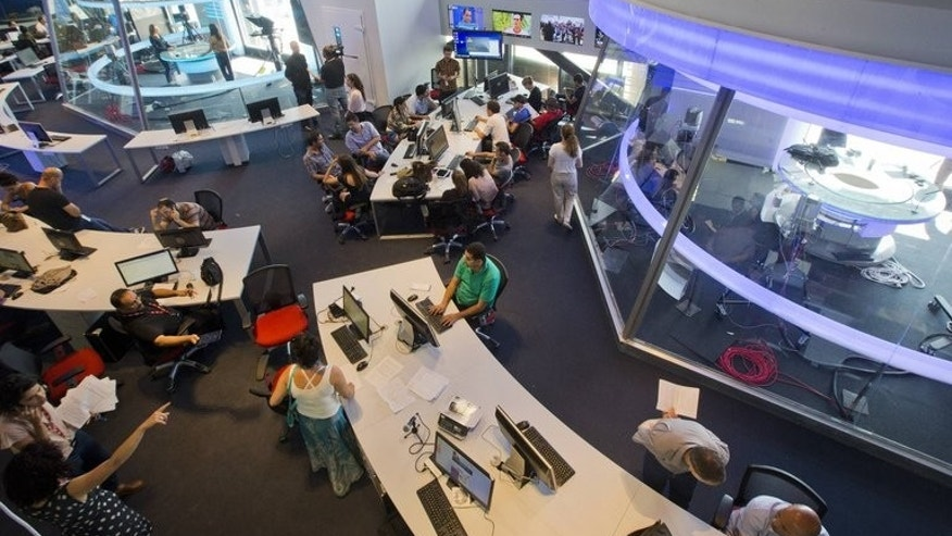 Staff at the headquarters of new Israeli-based TV channel i24news, in their newsroom on June 17, 2013 in Tel Aviv's Jaffa district.