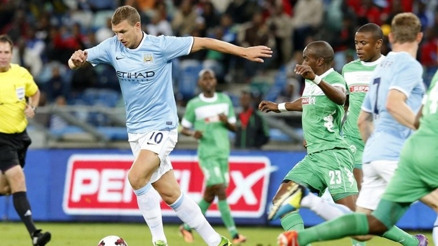 Edin Dzeko of Manchester City controls the ball during their Nelson Mandela Football Invitational match against AmaZulu of S.Africa, at Moses Mabhida Stadium in Durban, S.Africa, on July 18, 2013. AmaZulu won 2-1.