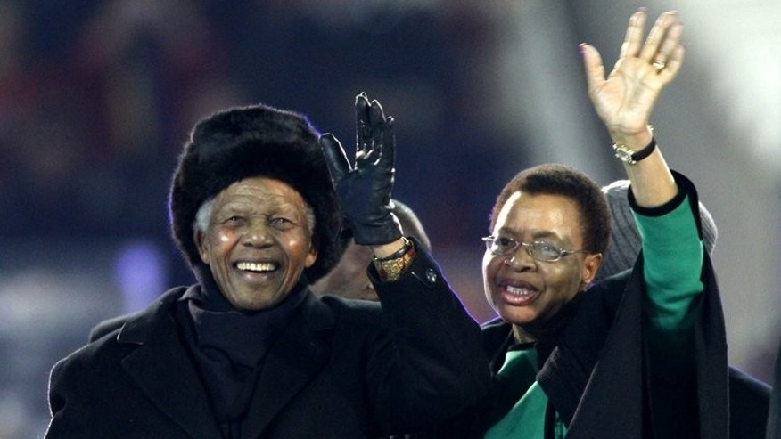 Nelson Mandela and Graca Machel greet fans before the 2010 World Cup final in Soccer City, Soweto. During the last six weeks Machel has kept a near round-the-clock vigil at her husband's hospital bedside, leaving to attend Mandela's charity events or visit their Johannesburg home.