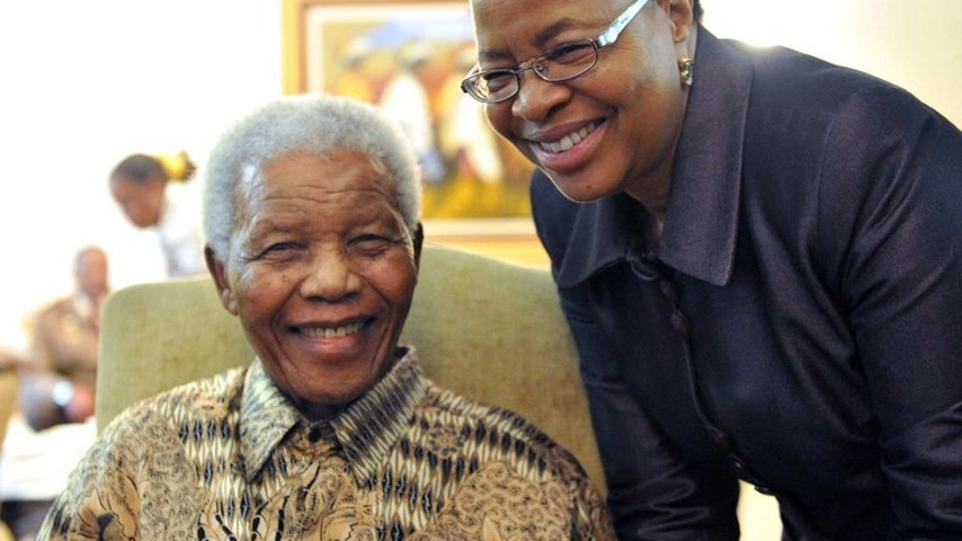 Nelson Mandela at home with Graca Machel in May 2011 after Mandela cast his vote in local elections. Machel married Mandela in 1998, 12 years after her first husband, Mozambique's former president Samora Machel, died in a mysterious plane crash.