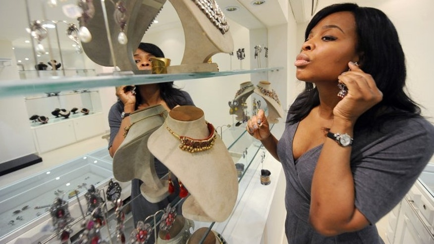 A customer tries on accessories at boutique Temple Muse in Lagos on June 14, 2013. Most of Nigeria's roughly 160 million people live in extreme poverty, but the upper class number among the wealthiest in Africa.