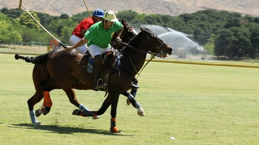 Iranian polo players compete on May 25, 2013 at the Qasr-e Firouze Chowgan Club, in the foothills of the Alborz mountains on the southeastern edge of Tehran.
