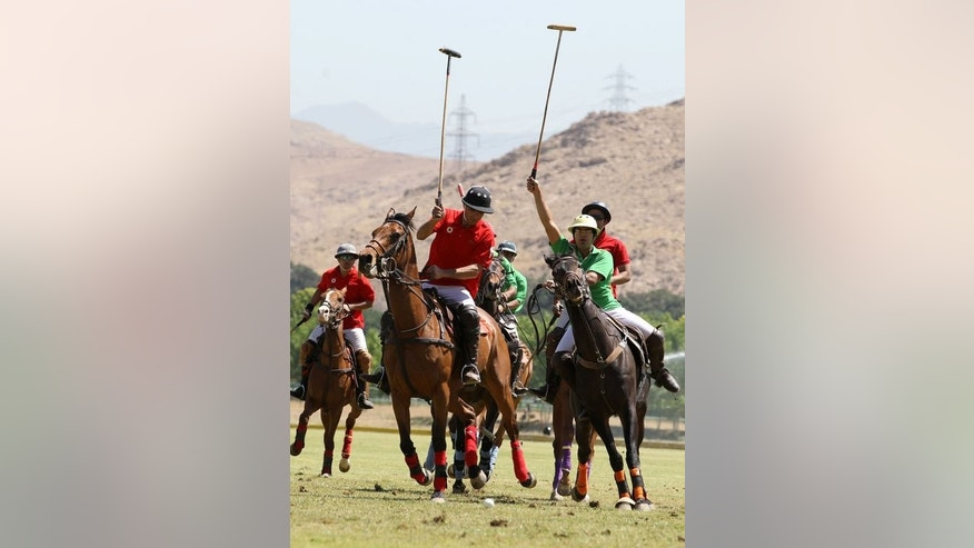 Iranian polo players compete during the final of the Polo Ghabrik Cup on May 25, 2013 at the Qasr-e Firouze Chowgan Club, in the foothills of the Alborz mountains on the southeastern edge of Tehran. Qasr-e Firouze is Farsi for the Turquoise Palace and chowgan means polo -- a game the Iranians say originated in Persia more than two millennia ago.