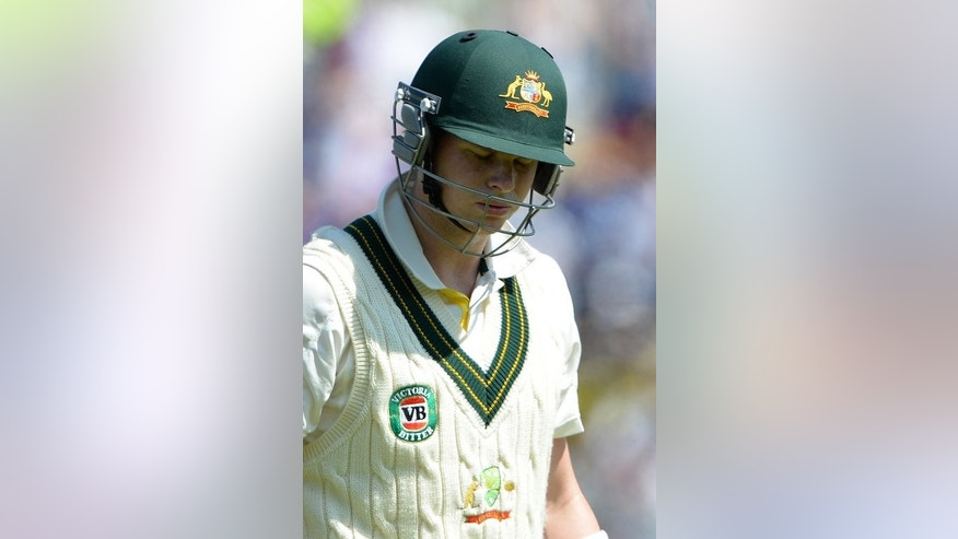 Australia's Steve Smith leaves the pitch following his dismissal during the second day's play of their first Test match of the Ashes series, at Trent Bridge in Nottingham, on July 11, 2013.
