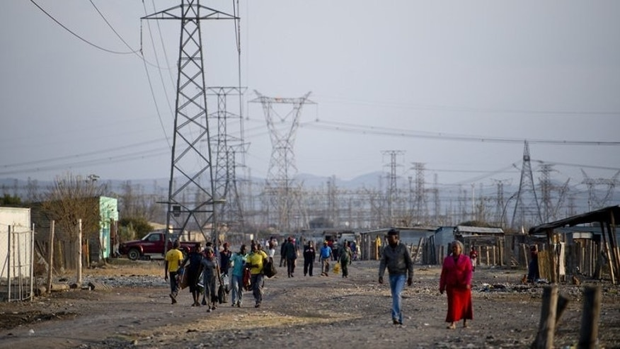 The Nkaneng shantytown next to the Lonmin platinum mine in Marikana last week. Ratings agency Moody's maintained South Africa's Baa1 sovereign debt rating on Thursday, praising a crimp on public spending and the possibility of a negotiated end to mining sector turmoil.