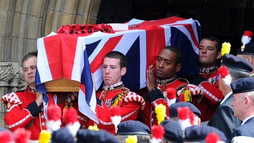July 12, 2013: The coffin of murdered Fusilier Lee Rigby is carried by soldiers after his funeral service at Bury Parish church in Greater Manchester, England. Relatives of the British soldier killed in broad daylight by alleged Islamic extremists say they are deeply grateful for the support they have received from the public ahead of his funeral on Friday. Lee Rigby was hacked to death May 22 on a London street near his army barracks.