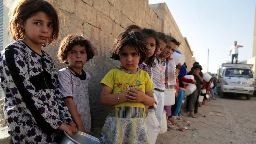 Children wait in line to collect a free iftar meal in Raqqa on July 14. Damascus is known across the Middle East for its varied confectionery tradition, with the city's sweet makers using pistachios, pine nuts, honey, lemon and rosewater for their mouthwatering recipes.
