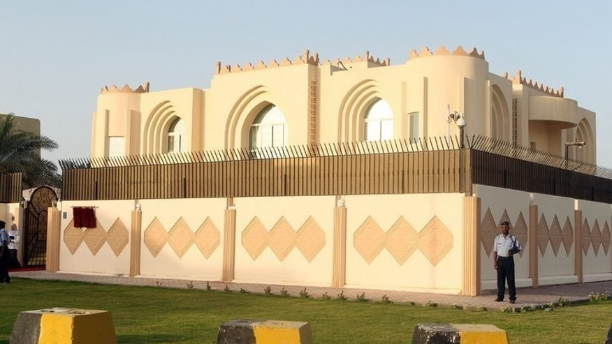 Security guards stand outside the new Taliban political office in the Qatari capital Doha before the official opening on June 18, 2013.The Taliban office in Doha was a plot to break up Afghanistan orchestrated by either Pakistan or the United States, a top aide to the Afghan president has said.