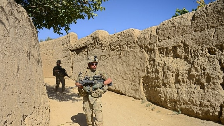 US soldiers patrol in Logar province, Afghanistan, on October 11, 2012. Taliban gunmen have shot dead eight Afghan civilians on their way to jobs at a US military base south of Kabul, officials said.