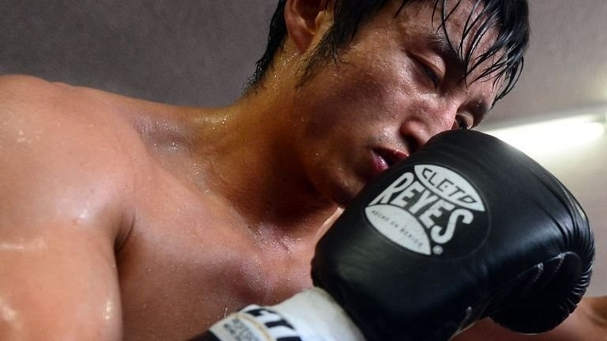 Two-time Olympic gold medallist Zou Shiming works out in Hollywood on July 11, 2013. He says that it is his dream to make it big in the United States, ahead of just his second bout as a professional fighter.