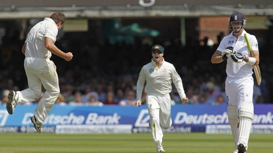 Ryan Harris (left) celebrates after taking the wicket of Kevin Pietersen (right) at Lord's on Thursday. Sydney-born Harris has a British passport because his father was born in Leicester and, while playing for English county Sussex in 2008, he had considered committing himself to his dad's country of birth.