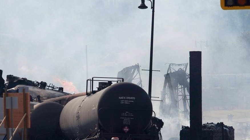 Wreckage continues to burn on July 7, 2013 after a freight train derailed in Lac-Megantic in Canada's Quebec province. Canada's Transportation Safety Board ordered railways Friday to check the brakes on all trains, after a preliminary investigation into the deadly derailment faulted its brakes.