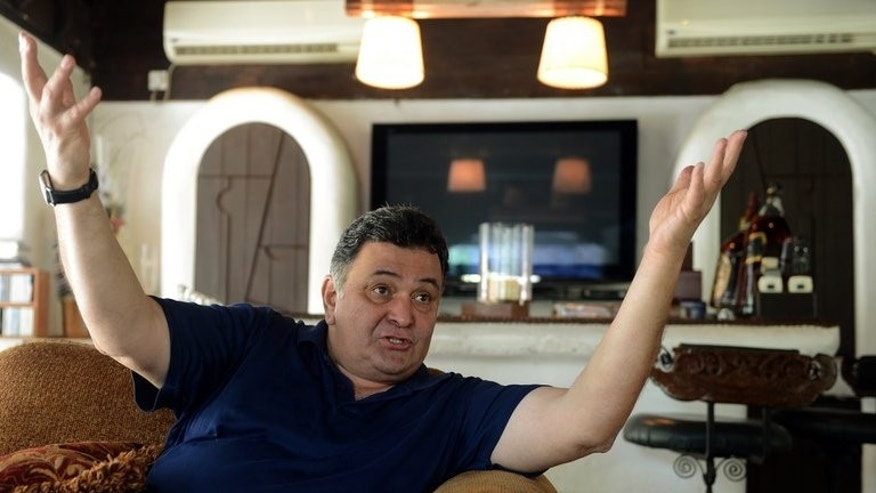 Indian Bollywood actor Rishi Kapoor gives an interview with AFP at his house in Mumbai on April 29, 2013. A string of Bollywood releases this year show the Indian film industry's ongoing fascination with Mumbai's underworld, following a murky history of links between the mafia and the movie business.