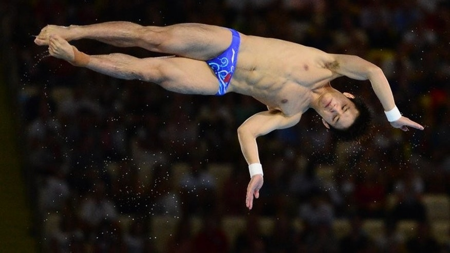 China's Qiu Bo competes in 10m platform final during the diving event at the London 2012 Olympic Games. China finished with 6 of the 8 gold diving medals on offer, but reigning world champion Qiu failed to add 10m platform Olympic gold to his world title despite dominating the 2011 Diving Series. But the 20-year-old has a new dive planned for aquatic championships starting Saturday in Barcelona.