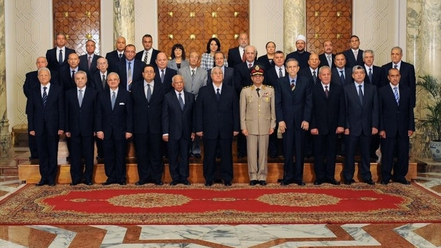 A picture released by the Egyptian presidency shows interim president Adly Mansour (C) and the new interim cabinet on July 16, 2013 in Cairo. The interim government tasked with putting Egypt back on track after president Mohamed Morsi's ouster faces enormous challenges, from fixing the shattered economy to restoring security and democracy, experts say.