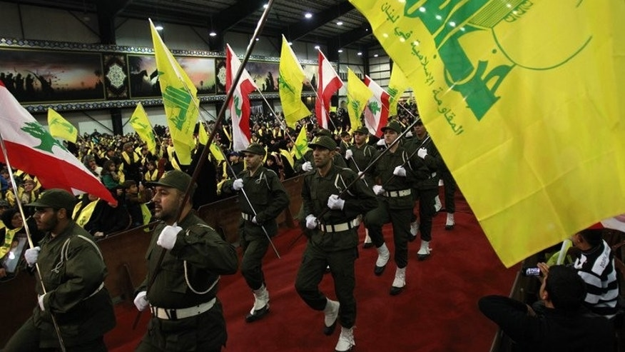 Members of Hezbollah wave the group's flag during a rally for the party's Martyrs' Day in Beirut on November 12, 2012. EU foreign ministers are likely to put the military wing of Lebanon's Hezbollah group on their blacklist of terror groups, EU diplomatic sources said Friday as the Lebanese government warned against such a step.