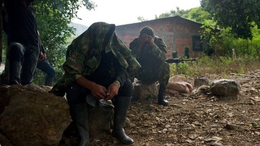 "FARC guerrillas in the rural area of Caloto, Colombia, on June 4, 2013. The leftist rebels said they captured a US soldier last month and are offering his release as a ""gesture"" toward peace with Bogota."