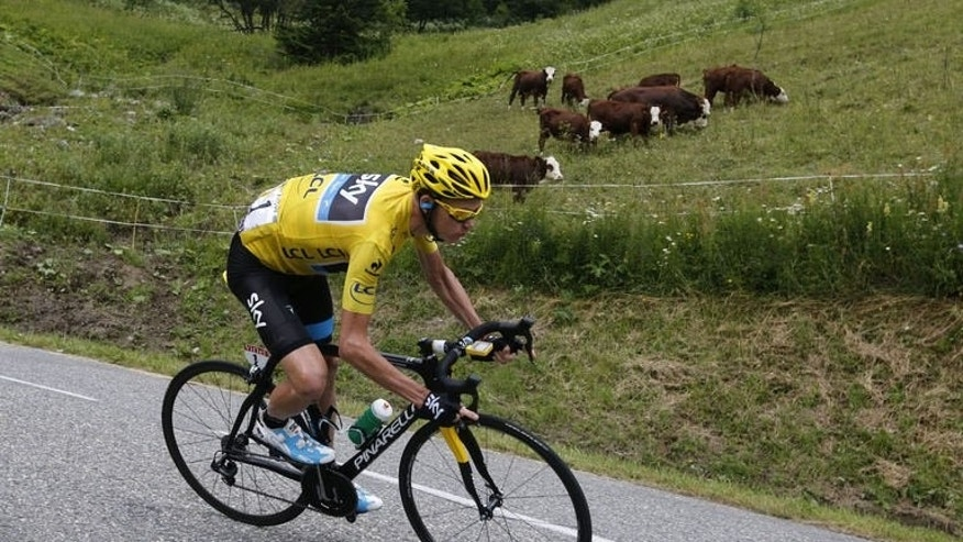 Overall leader's yellow jersey Britain's Chris Froome rides during the19th stage of the 100th edition of the Tour de France cycling race on July 19, 2013 between Bourg-d'Oisans and Le Grand-Bornand, French Alps.
