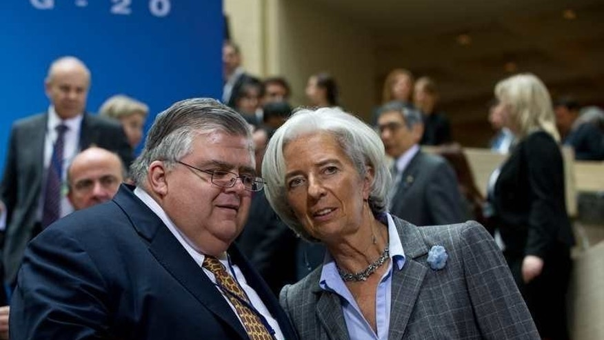 International Monetary Fund (IMF) Managing Director Christine Lagarde speaks with Mexican Central Bank governor Agustin Carstens following a G20 meeting in Washington on April 19, 2013. Finance ministers and central bankers The OECD on Friday presented G20 nations with a bold action plan seeking to help increasingly cash-strapped governments crack down on tax avoidance.