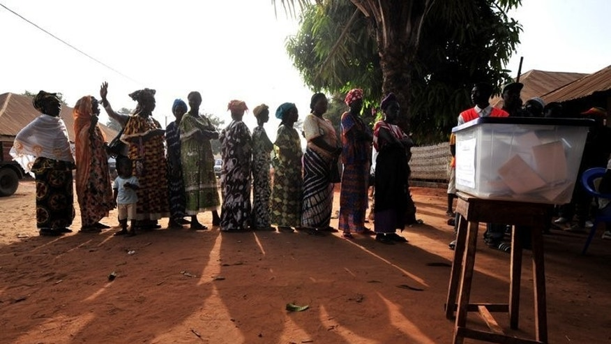 Women queue to vote in Bissau, on March 18, 2012 at a polling station. Guinea-Bissau outlawed domestic violence on Friday, winning praise from women's groups in a country where an estimated 60 percent of females are physically or sexually abused.